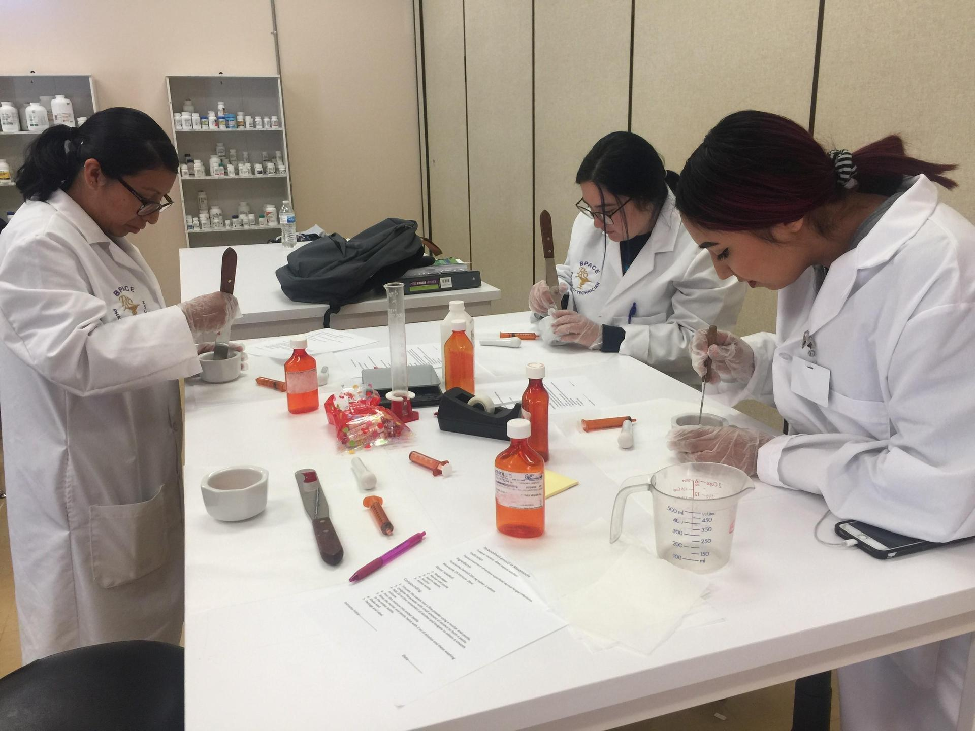 Pharmacy Tech. Students Practice Counting Medication