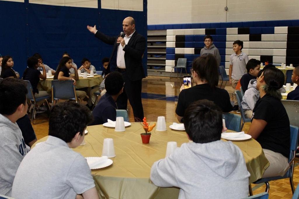 Principal Mr. Aleman talking to the children at the luncheon