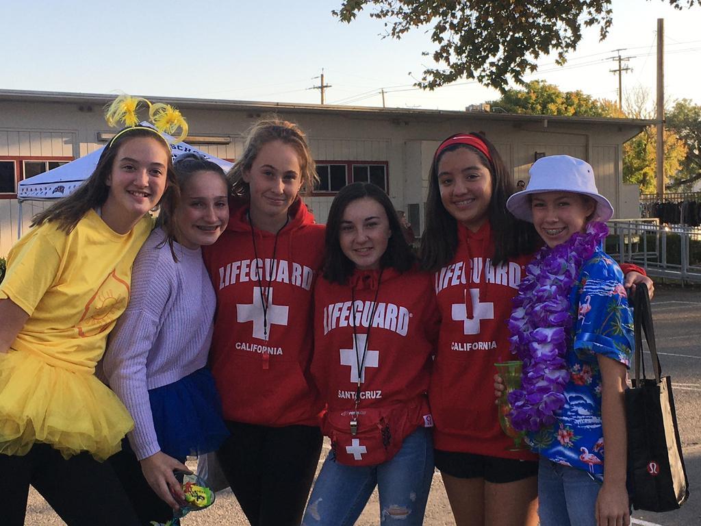 girls dressed up in life guard sweatshirts and hawaiian shirts