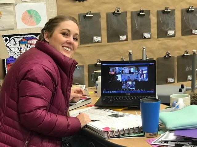 Ms. Whalen smiling as she conducts class via the Zoom online platform.