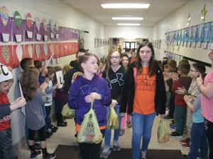EBOB students parade down the hallway as students wish them good luck.