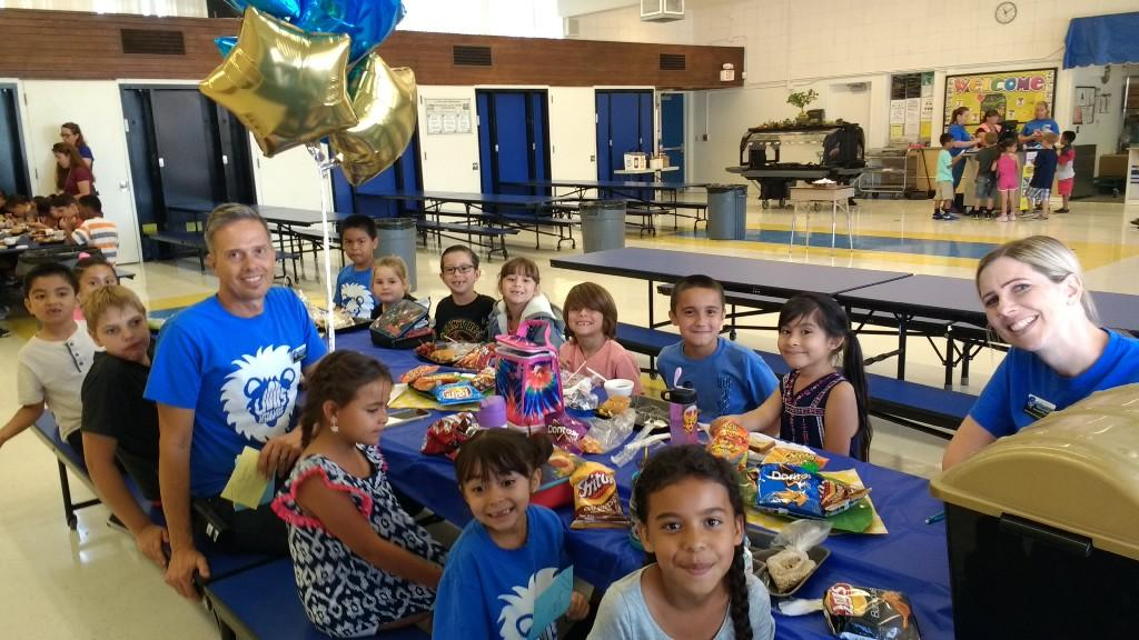 Mr. Broecker and Mrs. Grant and 3th grade winners of Lunch with the Principal