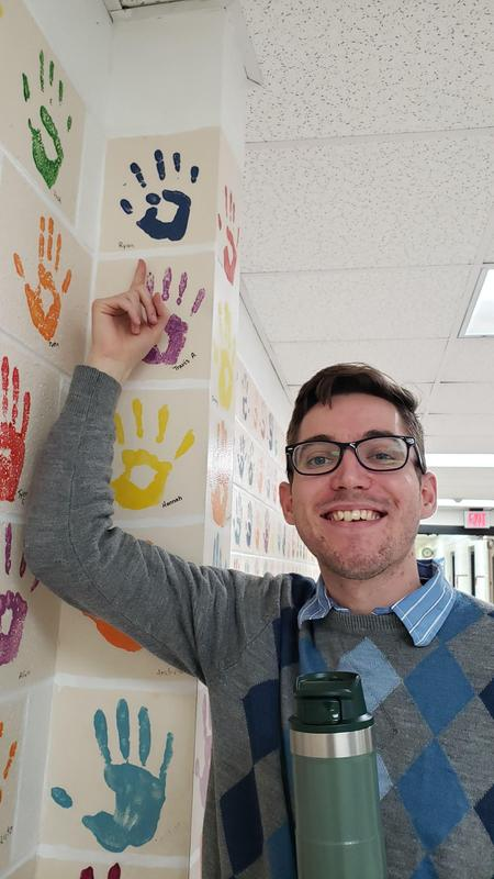 Mr. Blevins points to his handprint from his 5th grade year at CES