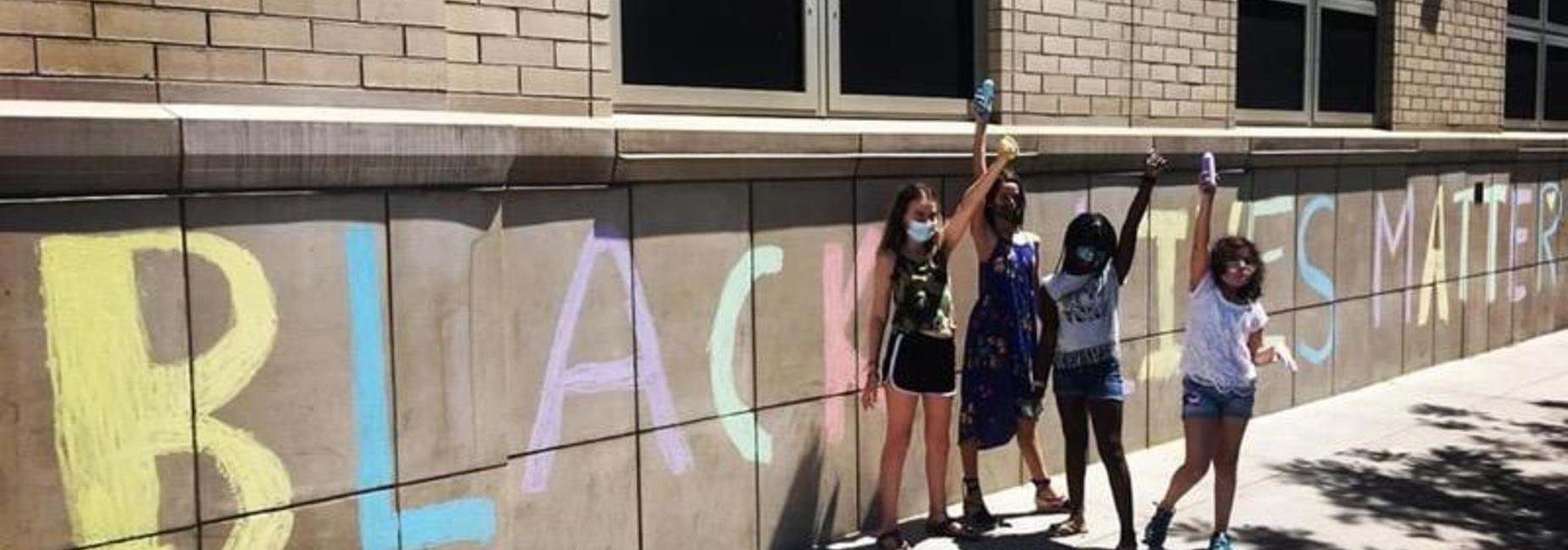 Black Lives Matter Mural in chalk on the school building