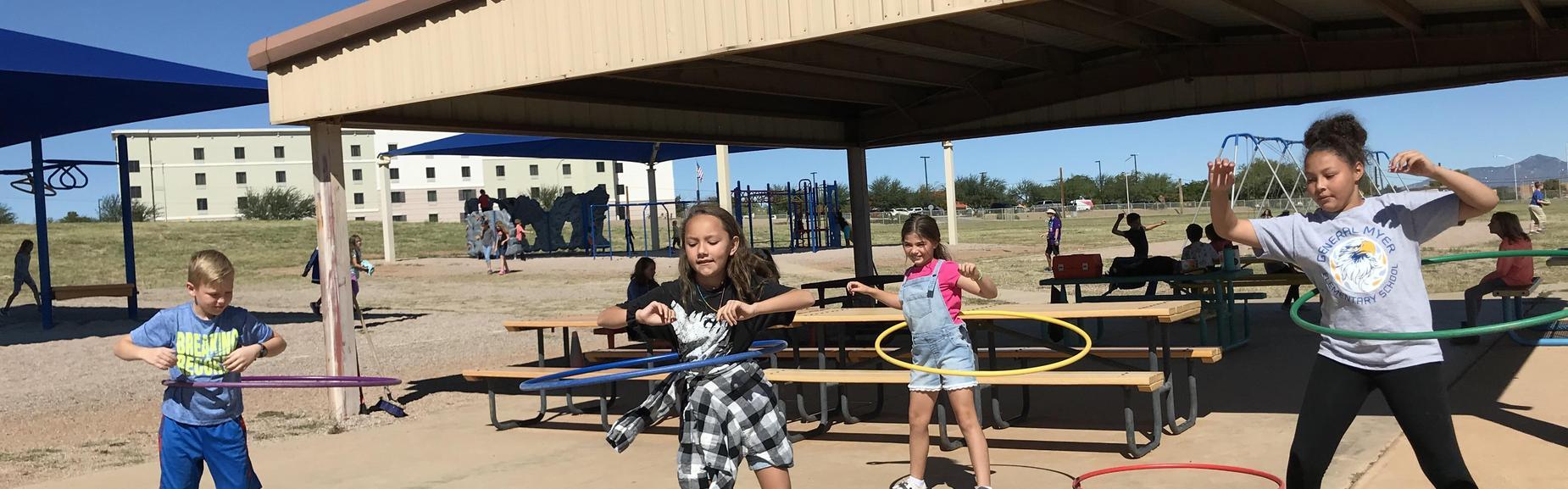 girls with hula hoops