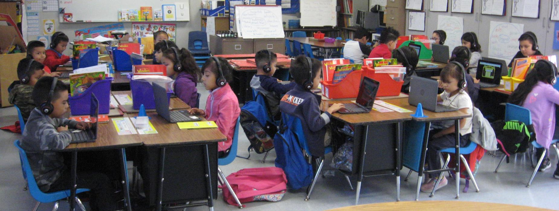 picture of first grade students using chromebooks