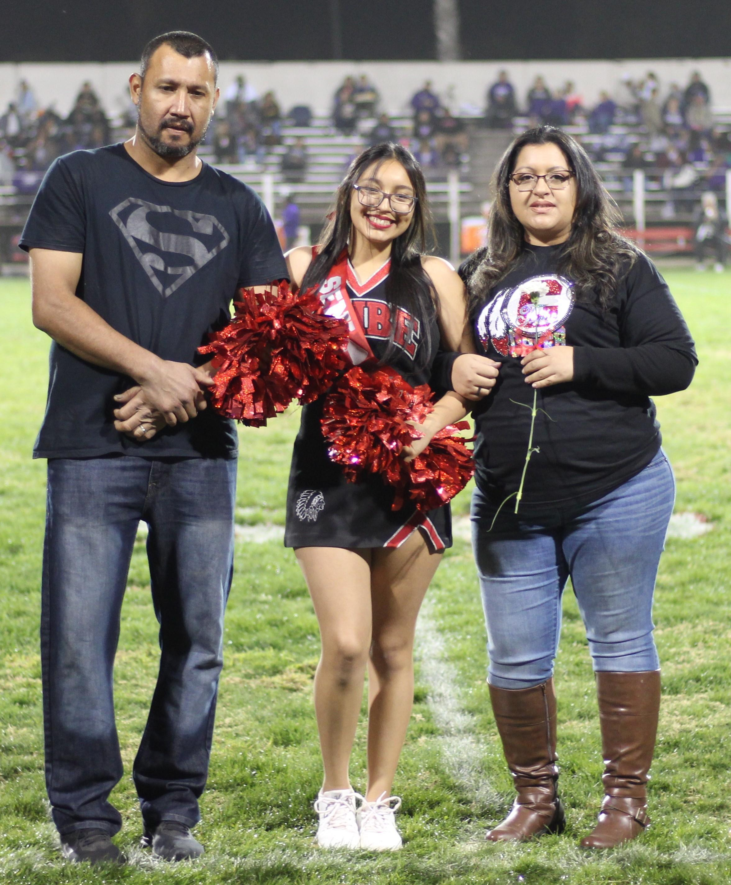 Senior cheerleader Angel Montez and her escorts.