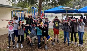 Elementary students using virtual reality goggles