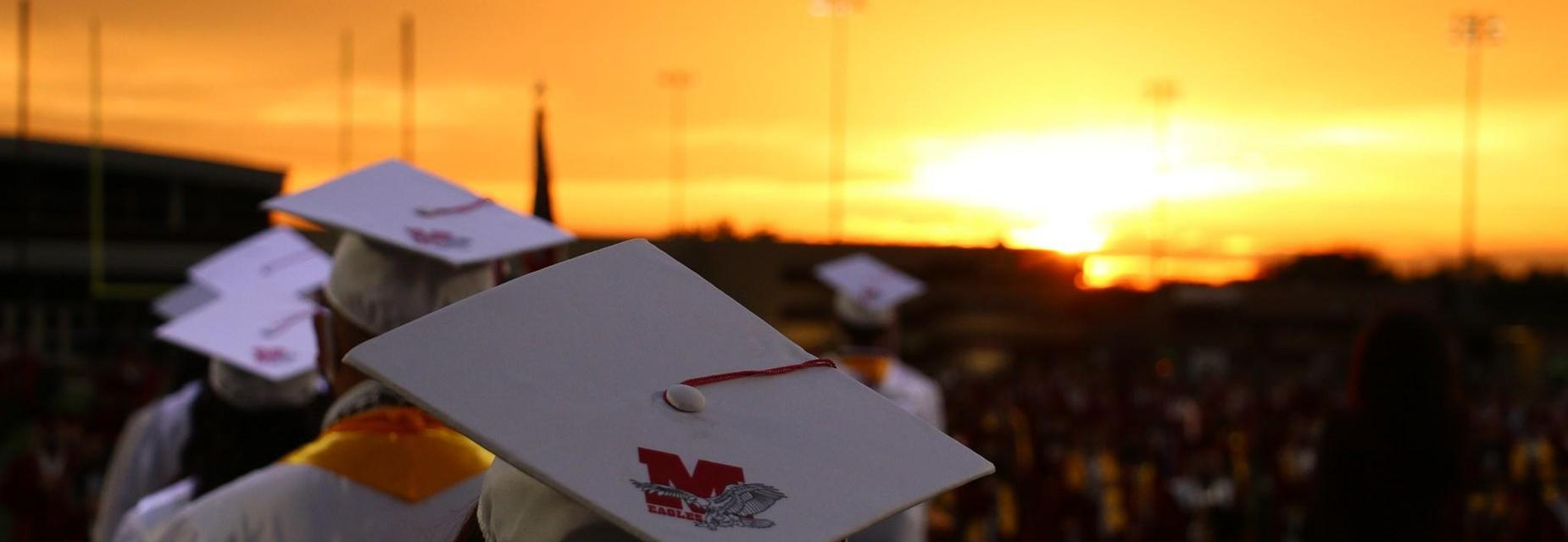 cap and gown at sunset