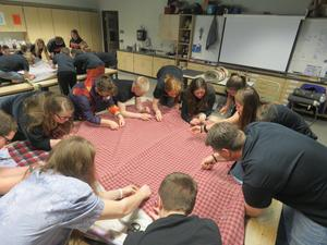 Thornapple Kellogg High School students sew blankets together to make sleeping bags for the homeless.