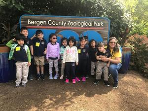 Pre-K class posing in front of the Bergen County zoological park sign