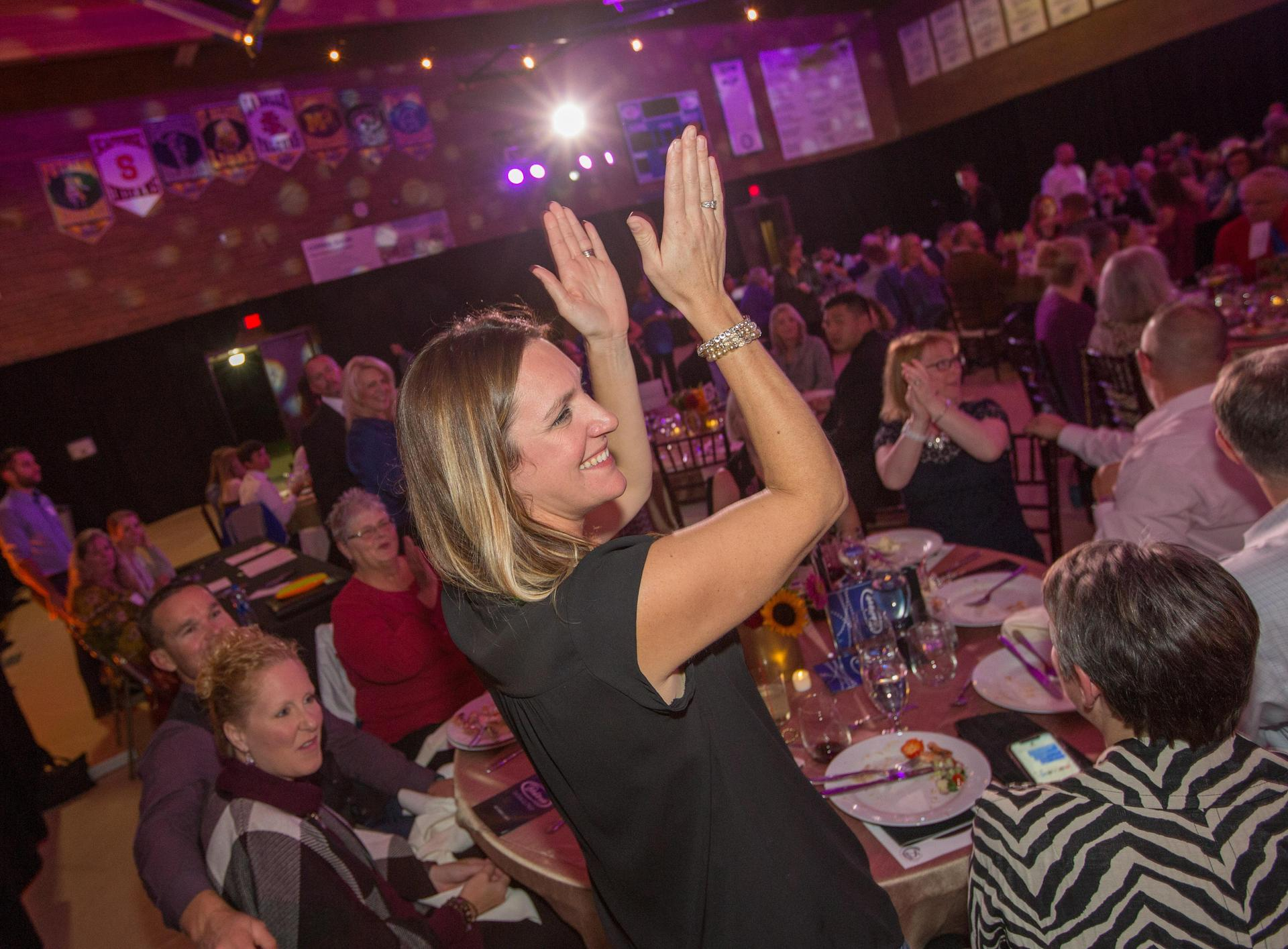 woman claps at event