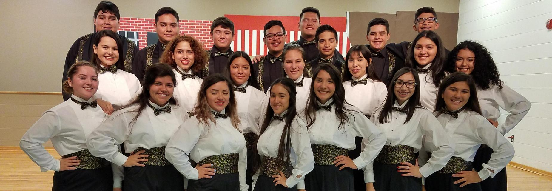 High School Choir students performed for Waitz