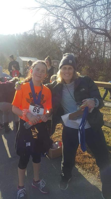 Ms wyatt and student at 5k race