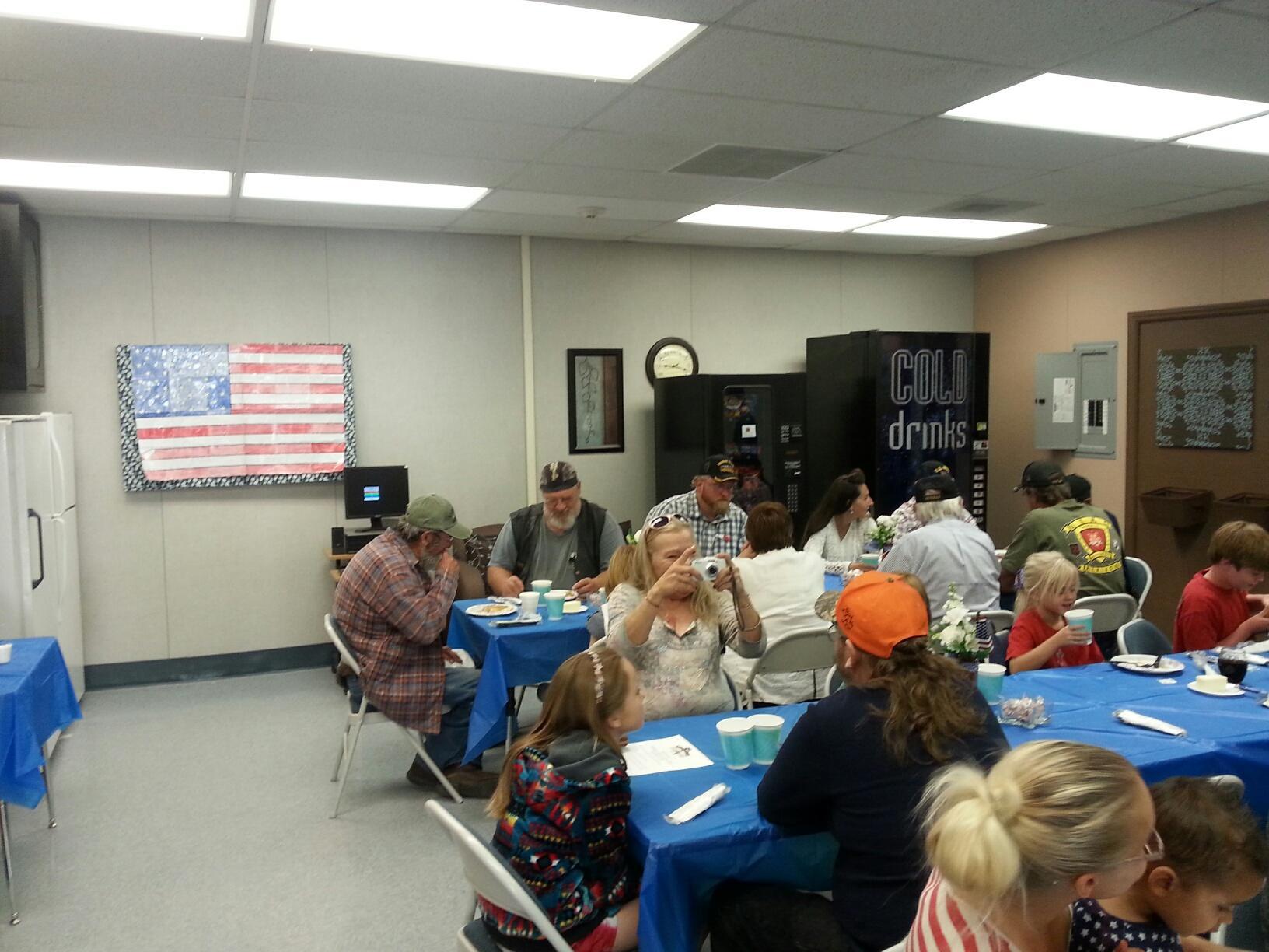 Veterans and their families enjoying breakfast
