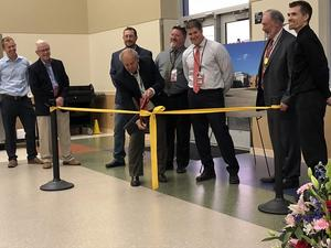 Ribbon cutting ceremony at Midway by Denny Denholm, School Board President.