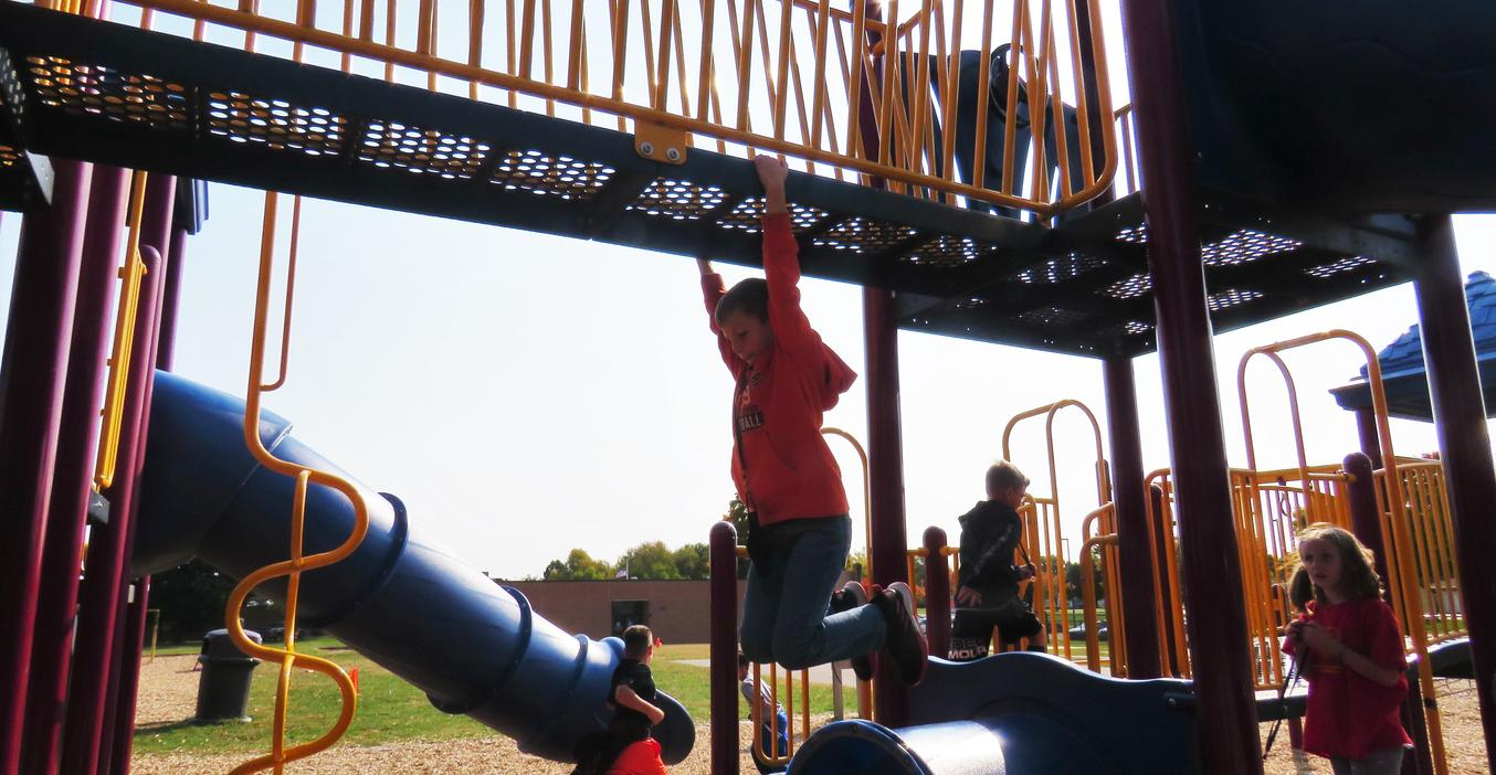 Lee students love playing on the play structure at recess.