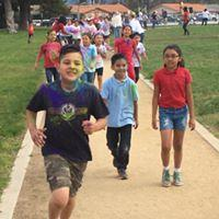 Students running in color run