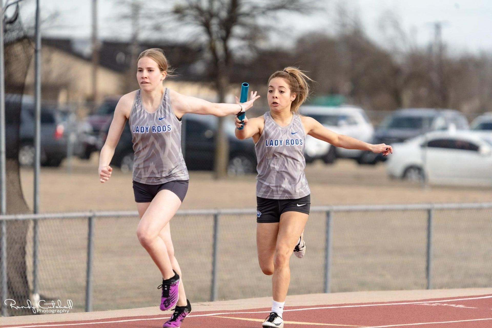 Lady Roos Passing the Baton During a Relay