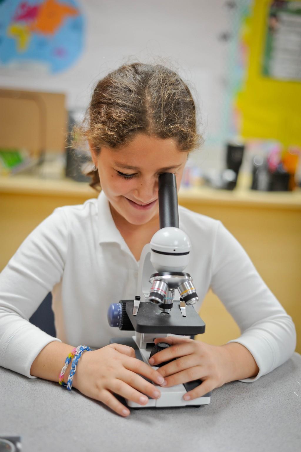 Girl looking in a microscope