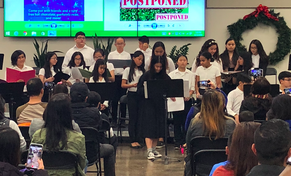 CCA choir standing on stage during the Winter Concert, 2019.
