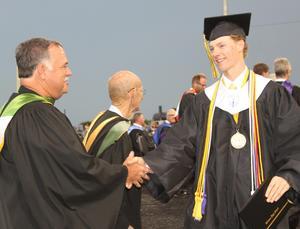 Trustee John Finnell congratulates CHS graduate