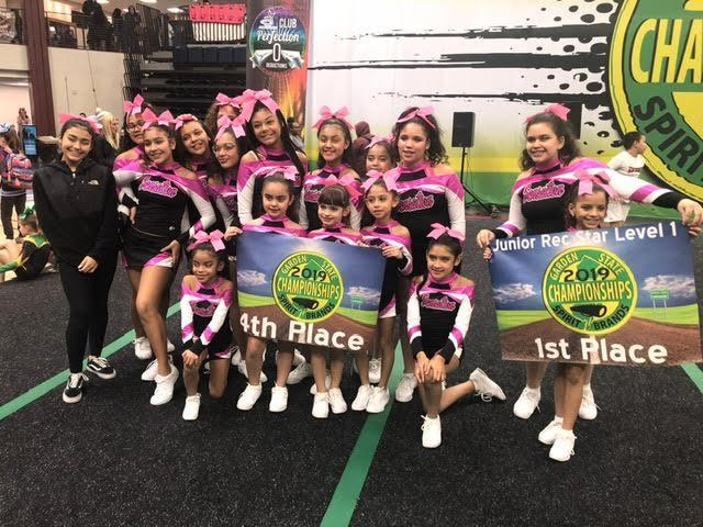 UC Cheer team 1st & 4th Place winners