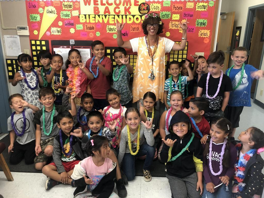 Mrs. Castillo and student's on Aloha Day