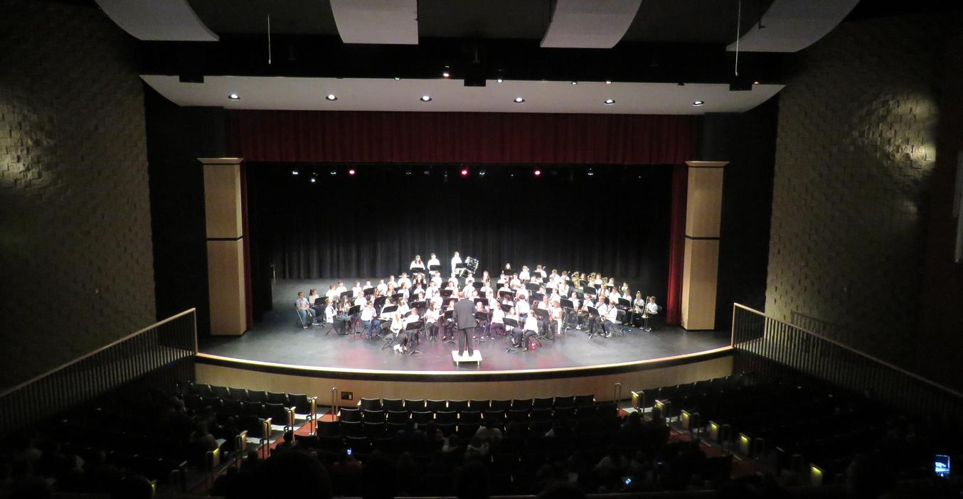 TKMS sixth-grade band performs in the high school auditorium.