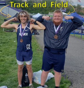 picture of two athletes wearing medals