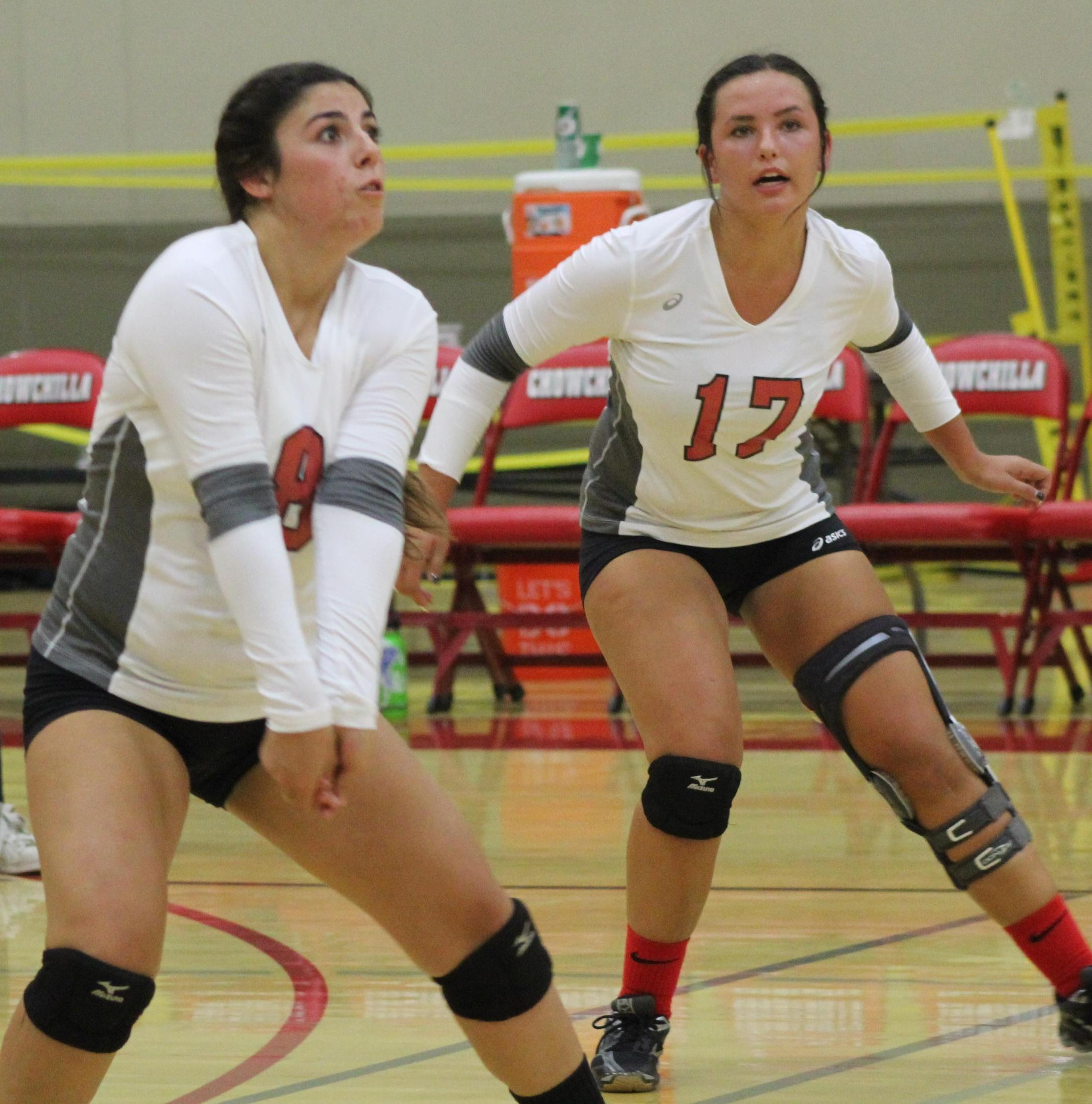Varsity girls playing volleyball against Sierra