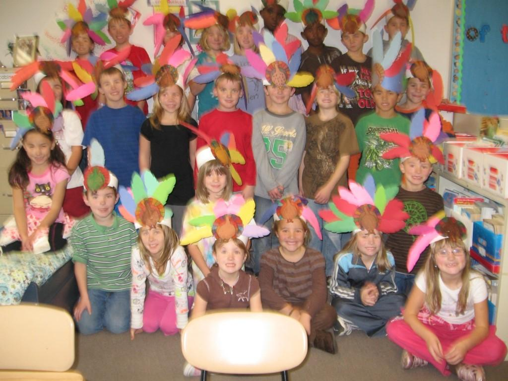 students celebrate Thanksgiving by making paper hats