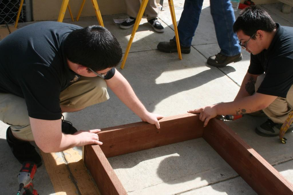 Students working on the greenhouse