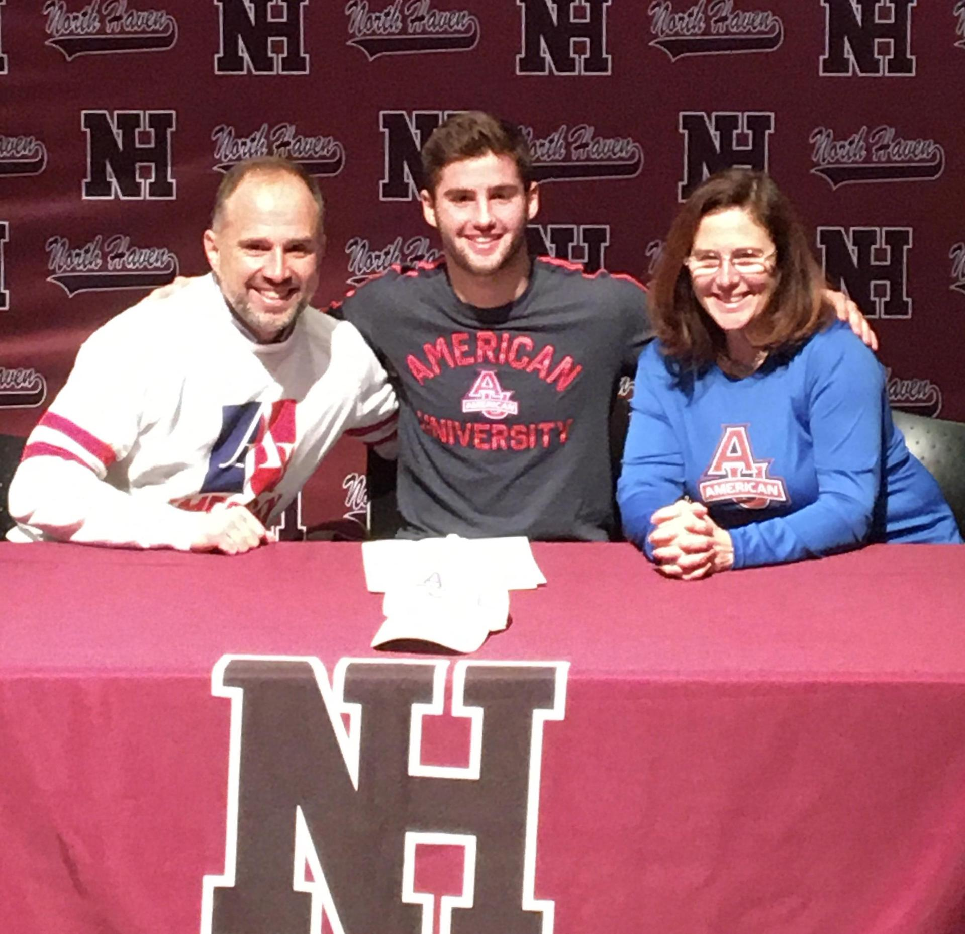 Evan Schweickert with his parents after signing his NLI.