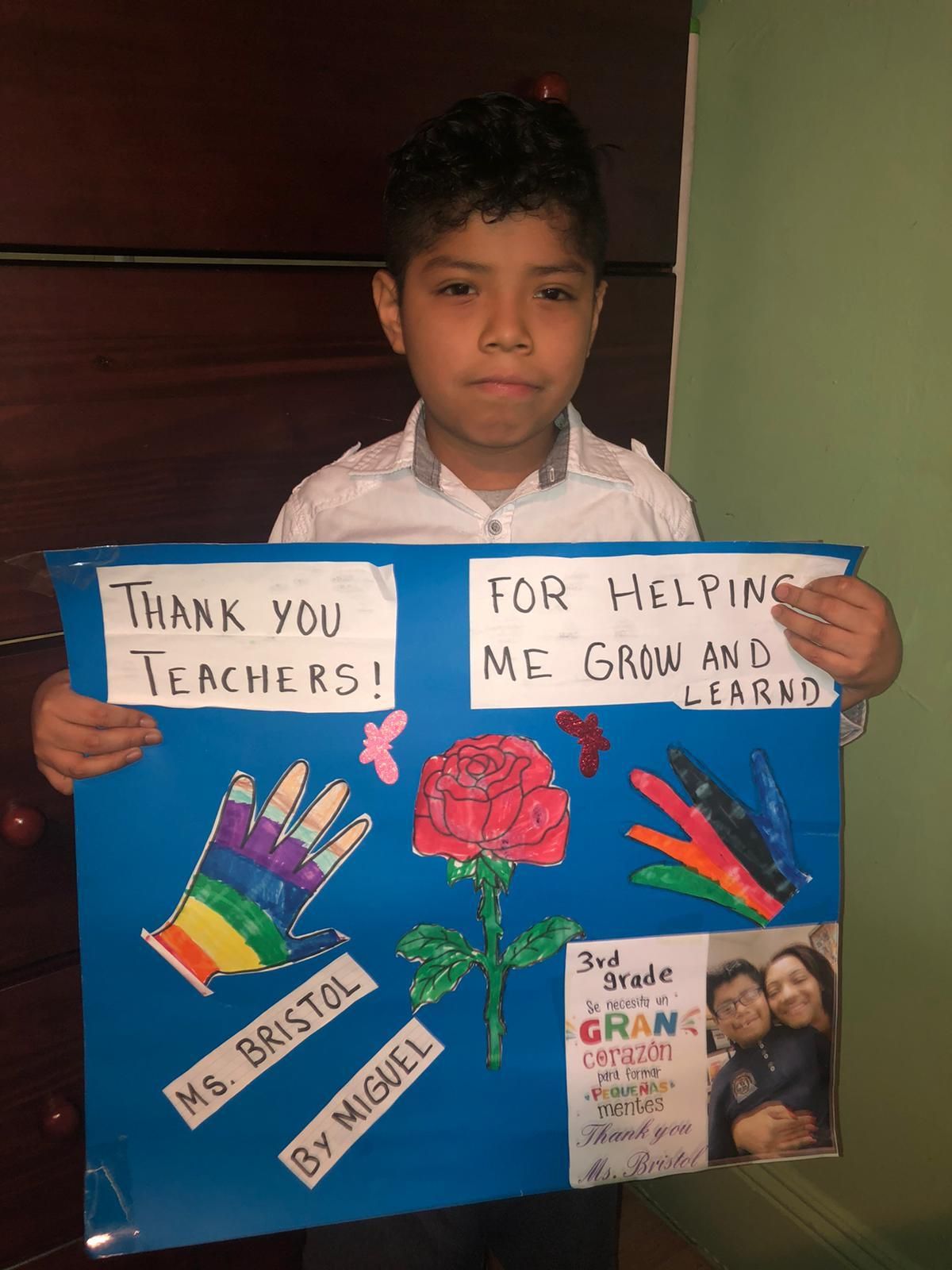 Miguel with his poster thanking Ms. Bristol