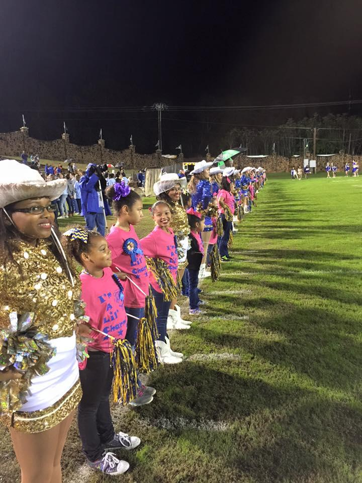 little charmers performing with real charmers during a game
