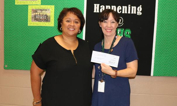 Mrs. Jackie Oberste, teacher at Eunice Jr. High, was the recipient of a check in the amount of $2000 from Walmart Distribution Center Community Grant Program.