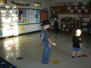Students walking in a cake walk.
