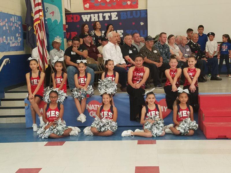 cheerleaders posing in gym.