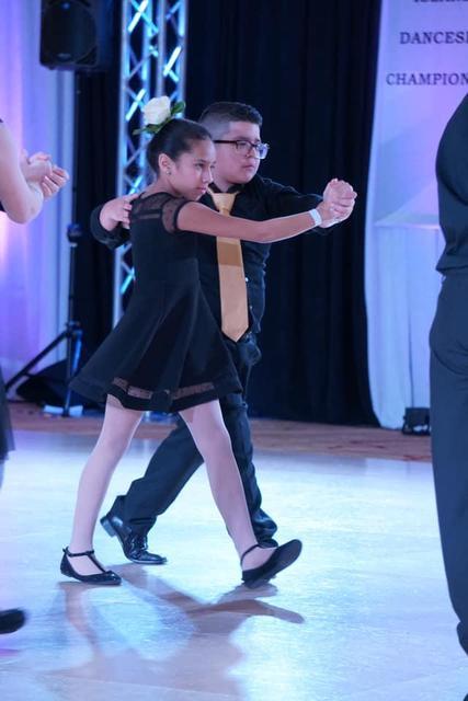 boy and girl walk dancing