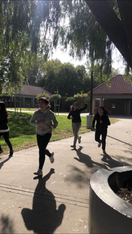 Students and Ms. Sun racing in the 2019 Turkey Trot.