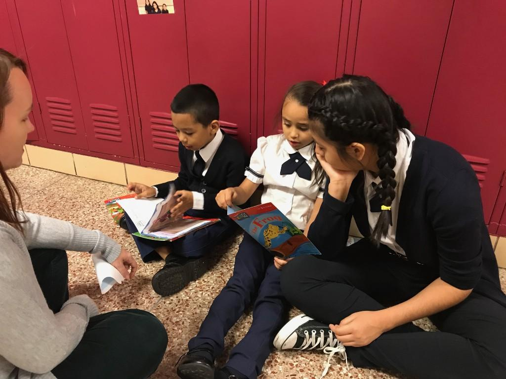 students reading in hallway
