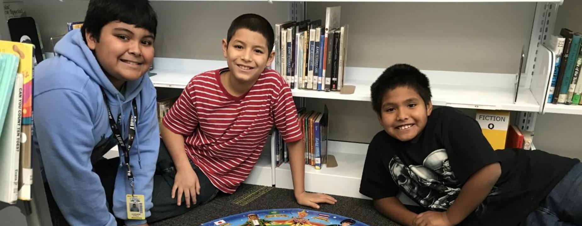 Elementary boys with puzzle at library