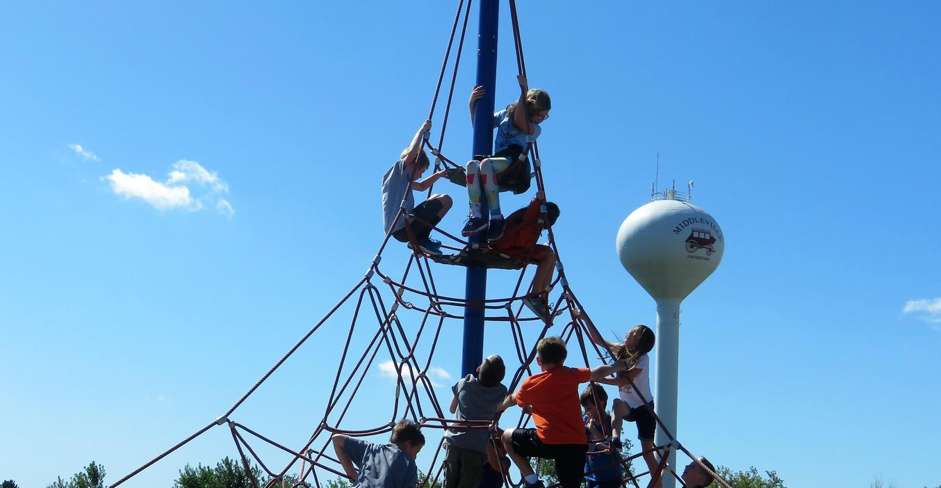 Students enjoy climbing on the playground.