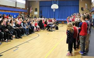 A photo of parents and other family members enjoying a Valentine's Day Singalong at Washington School.