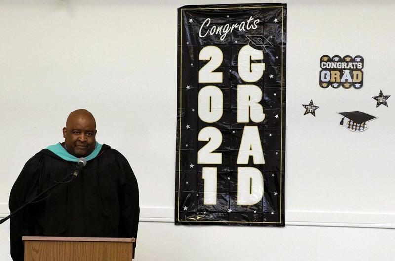 Chris Denmark at graduation ceremony