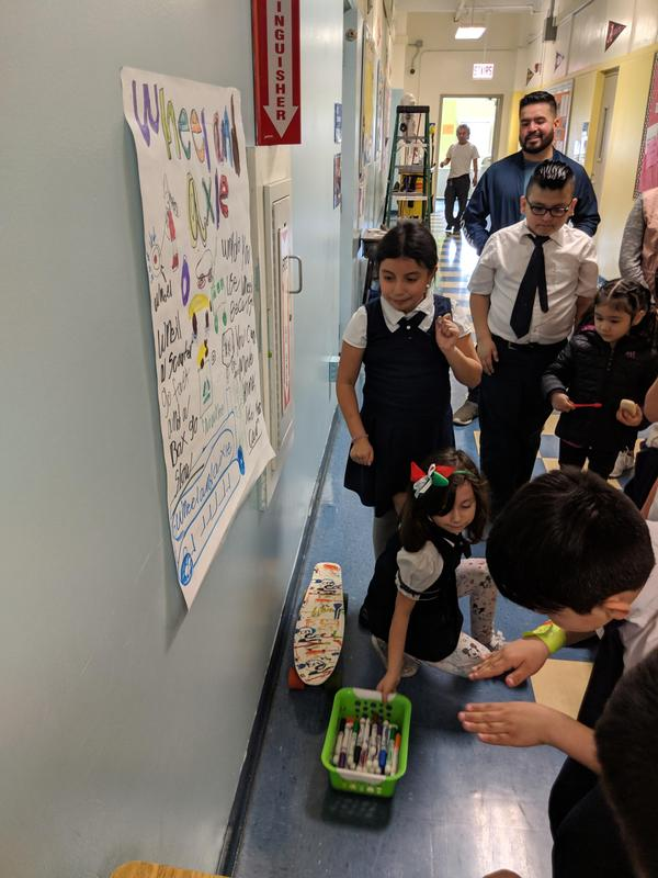 Students and families participate in a gallery walk about simple machines during STEM Explorers.