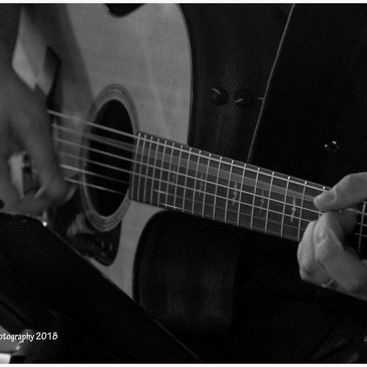 Mr. G playing guitar.