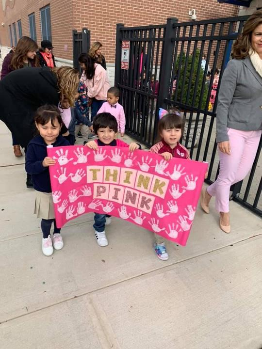 three kids holding a sign that says think pink