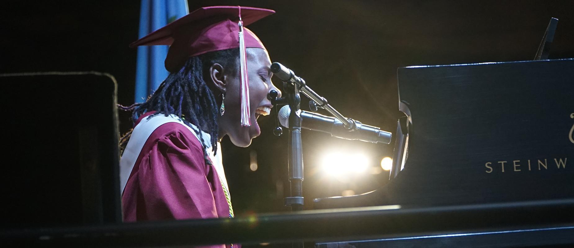Student playing piano at graduation